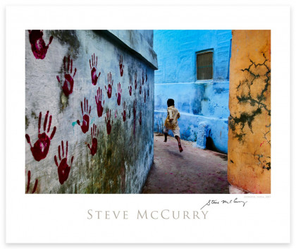Signed Poster: Boy in Mid Flight by Steve McCurry